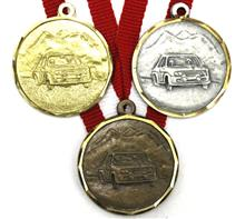 "Medaille Granat Autosport ""DS088"" inkl. Band:   Messingmedaille Ø32mm mit  geprägtem Relief-Motiv  ""AUTOSPORT"" inkl. Band."